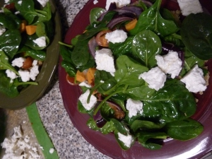 Spinach salad with roasted sweet potato, onions, lentils and feta